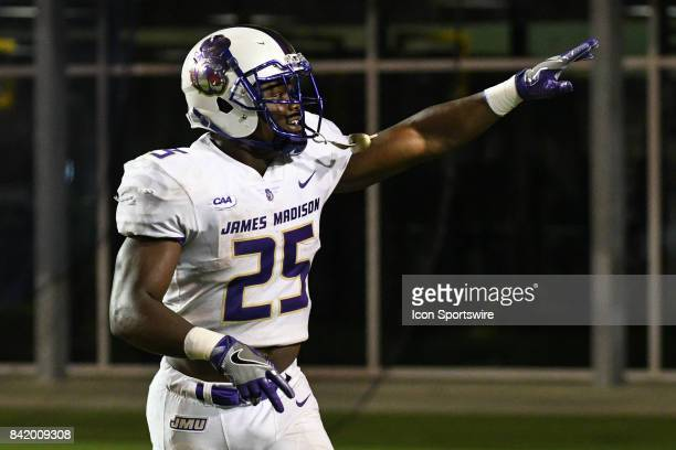 running back Cardon Johnson of the James Madison Dukes points to the stands during a game between the James Madison Dukes and the East Carolina...