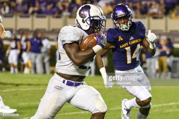 running back Cardon Johnson of the James Madison Dukes runs for a touchdown during a game between the James Madison Dukes and the East Carolina...