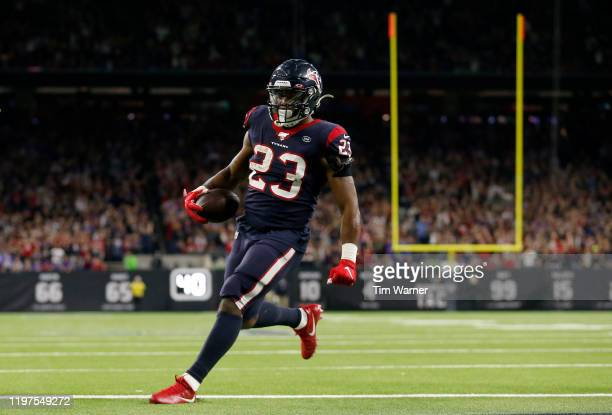 Running back Carlos Hyde of the Houston Texans runs in for a touchdown in the fourth quarter of the AFC Wild Card Playoff game against the Buffalo...