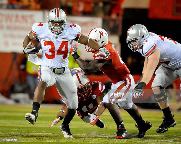 Running back Carlos Hyde of the Ohio State Buckeyes runs past cornerback Andrew Green of the Nebraska Cornhuskers and linebacker Lavonte David of the...