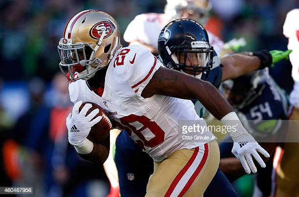 Running back Carlos Hyde of the San Francisco 49ers runs with the ball during the first quarter of the game against the Seattle Seahawks at...