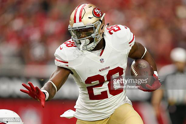 Running back Carlos Hyde of the San Francisco 49ers rushes the football during the first quarter NFL game against the Arizona Cardinals at the...