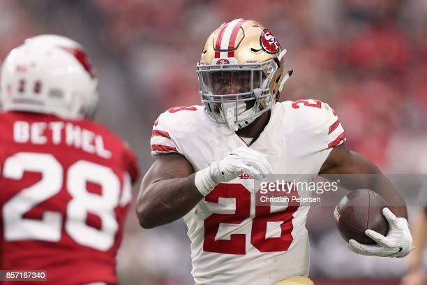 Running back Carlos Hyde of the San Francisco 49ers rushes the football against the Arizona Cardinals during the NFL game at the University of...