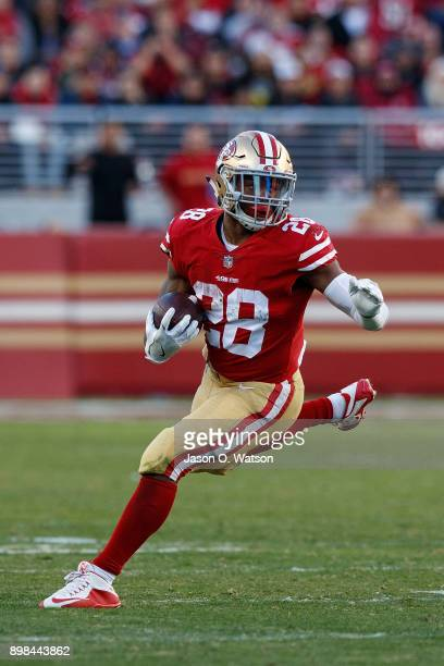 Running back Carlos Hyde of the San Francisco 49ers rushes up field against the Tennessee Titans during the fourth quarter at Levi's Stadium on...
