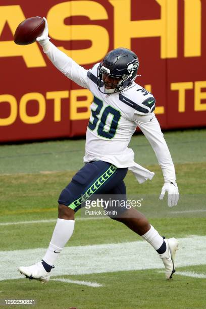 Running back Carlos Hyde of the Seattle Seahawks celebrates while crossing the goal line to score a 2third quarter touchdown against the Washington...
