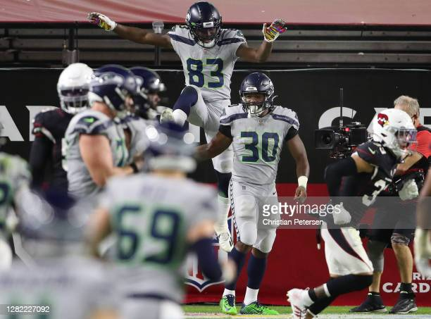 Running back Carlos Hyde of the Seattle Seahawks celebrates with teammates after Hyde scored a rushing touchdown against the Arizona Cardinals in the...