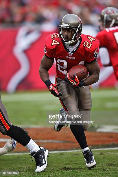 Running back Carnell 'Cadillac' Williams of the Tampa Bay Buccaneers carries the ball during a NFL game against the Detroit Lions on December 19 2010...