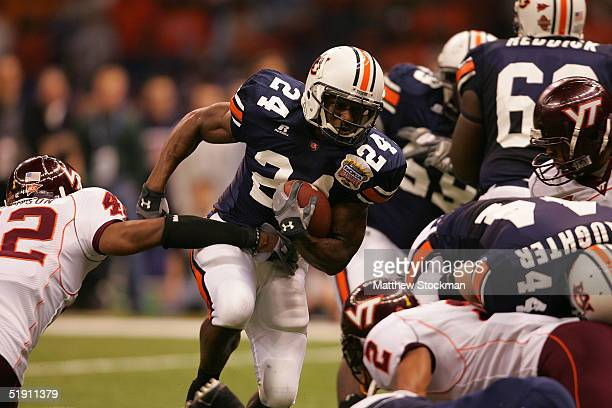 Running back Carnell Williams of the Auburn Tigers runs with the ball against the Virginia Tech Hokies during the Nokia Sugar Bowl on January 3 2005...