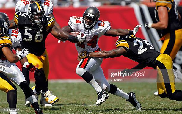 Running back Carnell Williams of the Tampa Bay Buccaneers runs through the tackle of safety Ryan Clark of the Pittsburgh Steelers during the game at...
