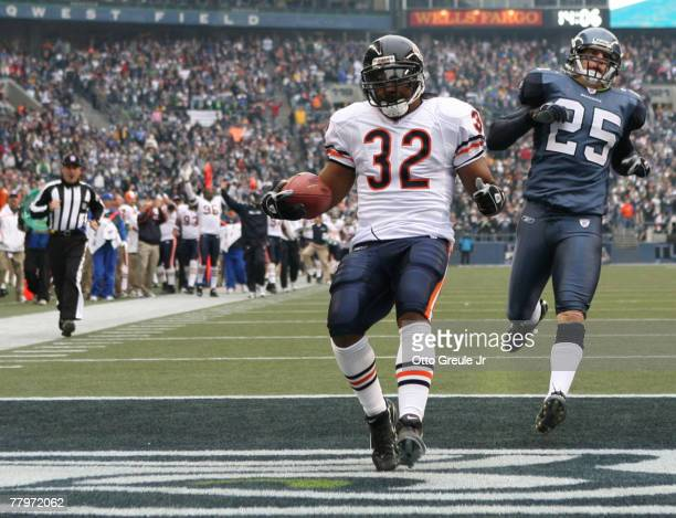 Running back Cedric Benson of the Chicago Bears scores a touchdown in the first quarter against Brian Russell of the Seattle Seahawks at Qwest Field...