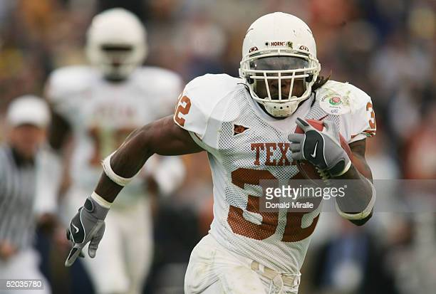 Running back Cedric Benson of the Texas Longhorns looks for room to run against the Michigan Wolverines in the 91st Rose Bowl Game at the Rose Bowl...