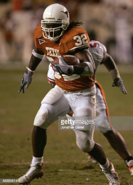 Running back Cedric Benson of the Texas Longhorns runs upfield against the Oklahoma State Cowboys during the game on November 06, 2004 at DKR...