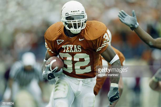 Running back Cedric Benson of the University of Texas at Austin Longhorns scores a touchdown during a game against the Texas A&M University Aggies at...