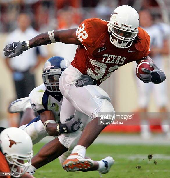 Running back Cedric Benson of the University of Texas Longhorns runs the ball against the University of Rice Owls on September 25 2004 at...