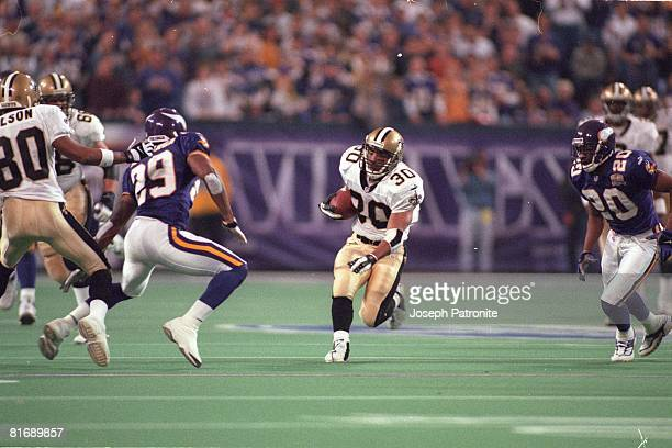 Running back Chad Morton of the New Orleans Saints runs upfield against the Minnesota Vikings in the 2000 NFC Divisional Playoff Game at the...