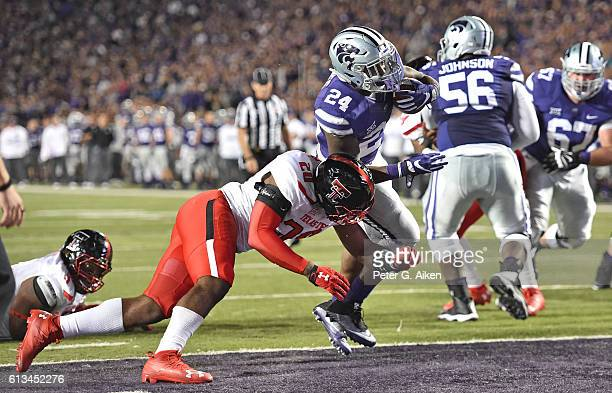 Running back Charles Jones of the Kansas State Wildcats rushes in for a touchdown against linebacker Jordyn Brooks of the Texas Tech Red Raiders...