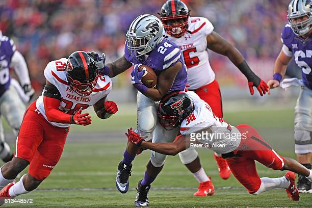 Running back Charles Jones of the Kansas State Wildcats rushes up field against defender Jordyn Brooks of the Texas Tech Red Raiders during the first...