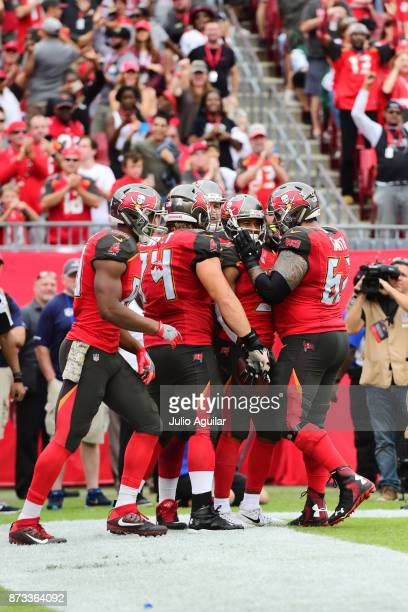 Running back Charles Sims of the Tampa Bay Buccaneers celebrates after scoring a touchdown against the New York Jets in the fourth quarter on...