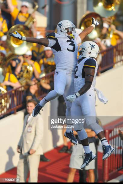 Running back Charles Sims of the West Virginia Mountaineers celebrates a touchdown with running back Dreamius Smith against the Oklahoma Soonerson...