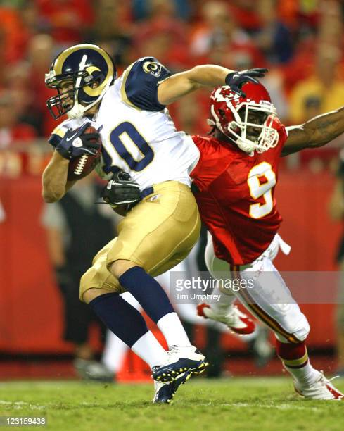 Running back Chase Reynolds of the St Louis Rams is tackled by Josue Paul of the Kansas City Chiefs at Arrowhead Stadium on August 26 2011 in Kansas...