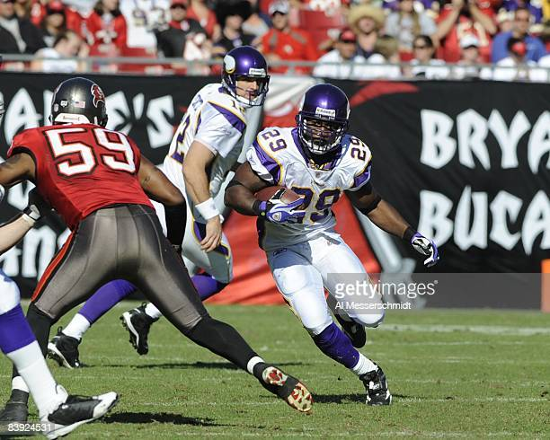 Running back Chester Taylor of the Minnesota Vikings rushes upfield against the Tampa Bay Buccaneers at Raymond James Stadium on November 16 2008 in...