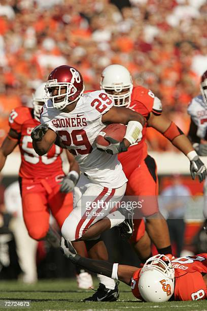 Running back Chris Brown of the Oklahoma Sooners runs against the Oklahoma State Cowboys on November 25 2006 at Boone Pickens Stadium in Stillwater...