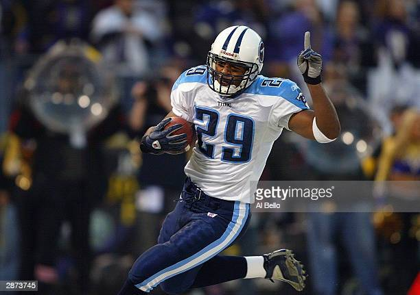 Running back Chris Brown of the Tennessee Titans celebrates while running the ball during the AFC Wildcard playoff game against the Baltimore Ravens...