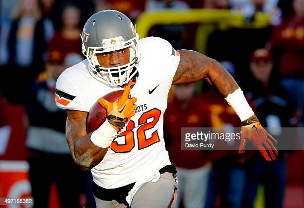 Running back Chris Carson of the Oklahoma State Cowboys drives the ball in for a touchdown in the first half of play against the Iowa State Cyclones...