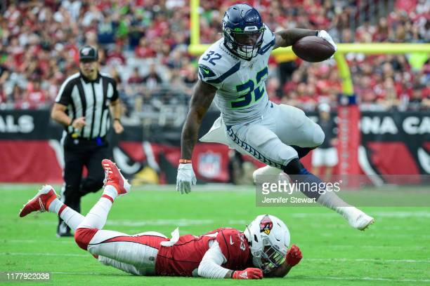 Running back Chris Carson of the Seattle Seahawks carries the ball against cornerback Byron Murphy of the Arizona Cardinals in the first half of the...