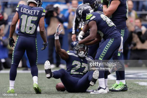 Running Back Chris Carson of the Seattle Seahawks celebrates a touchdown with teammates in the first half against the Los Angeles Rams at CenturyLink...