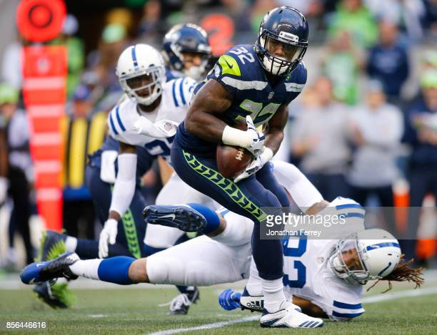 Running back Chris Carson of the Seattle Seahawks is tackled by Jabaal Sheard of the Indianapolis Colts in the first quarter of the game at...