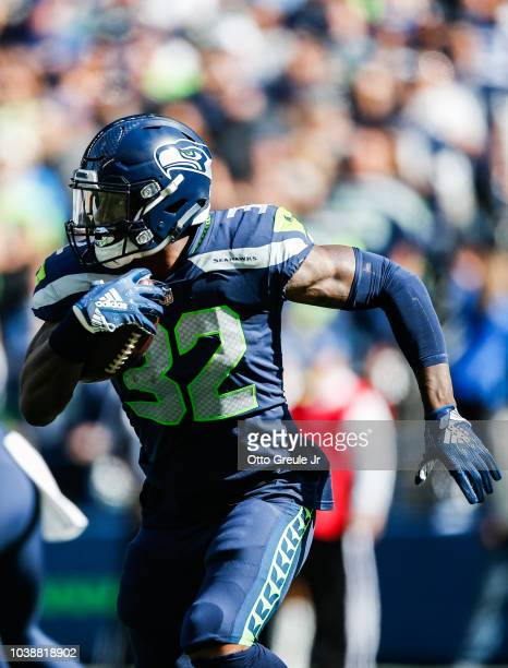 Running Back Chris Carson of the Seattle Seahawks runs against the Dallas Cowboys at CenturyLink Field on September 23 2018 in Seattle Washington
