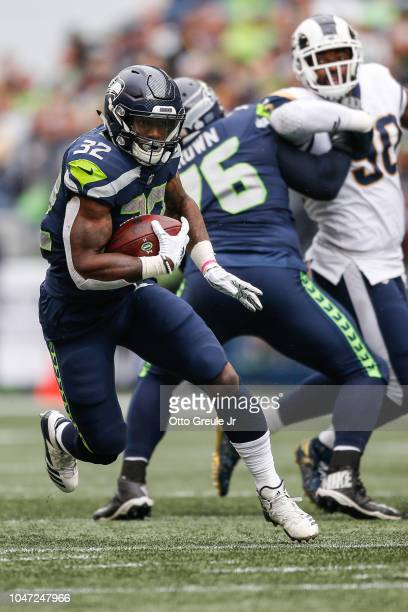 Running Back Chris Carson of the Seattle Seahawks runs the ball in the first half against the Los Angeles Rams at CenturyLink Field on October 7 2018...