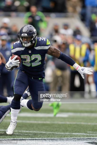 Running back Chris Carson of the Seattle Seahawks runs the ball in the second half against the Los Angeles Rams at CenturyLink Field on October 7...