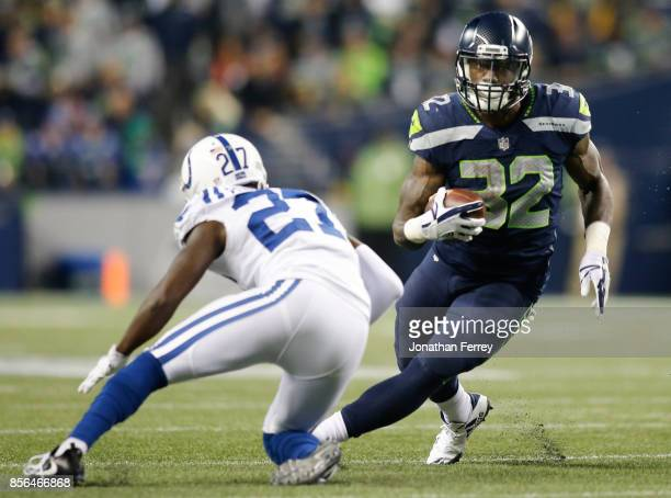 Running back Chris Carson of the Seattle Seahawks rushes against Nate Hairston of the Indianapolis Colts in the third quarter of the game at...