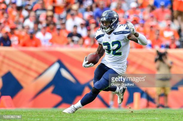Running back Chris Carson of the Seattle Seahawks rushes against the Denver Broncos at Broncos Stadium at Mile High on September 9 2018 in Denver...