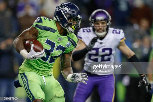 Running back Chris Carson of the Seattle Seahawks rushes against the Minnesota Vikings at CenturyLink Field on December 10 2018 in Seattle Washington