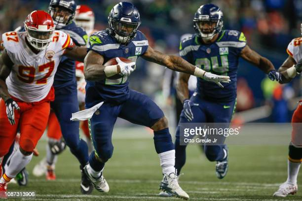 Running back Chris Carson of the Seattle Seahawks rushes against the Kansas City Chiefs at CenturyLink Field on December 23 2018 in Seattle Washington