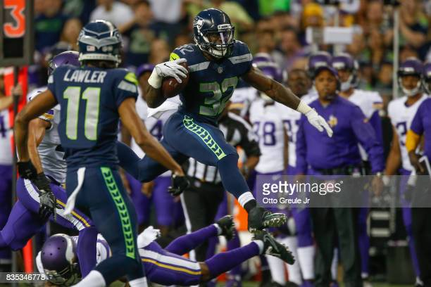 Running back Chris Carson of the Seattle Seahawks rushes against the Minnesota Vikings at CenturyLink Field on August 18 2017 in Seattle Washington