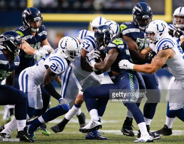 Running back Chris Carson of the Seattle Seahawks rushes against the Indianapolis Colts in the second quarter of the game at CenturyLink Field on...