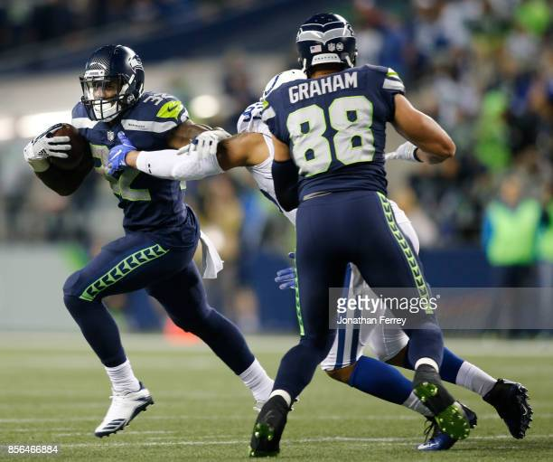 Running back Chris Carson of the Seattle Seahawks rushes against the Indianapolis Colts in the third quarter of the game at CenturyLink Field on...