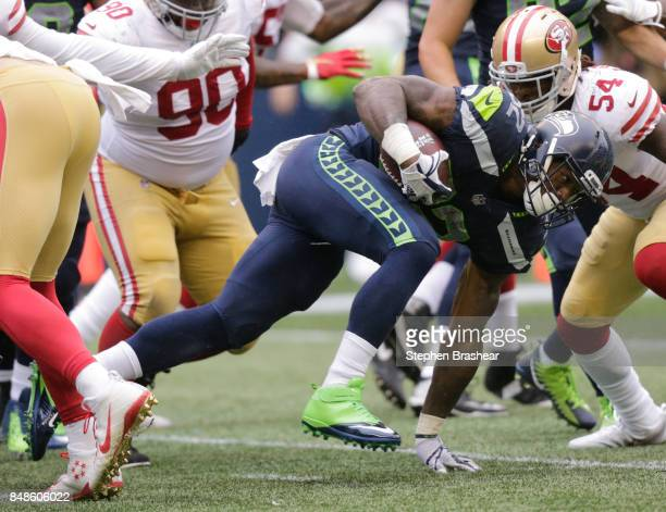 Running back Chris Carson of the Seattle Seahawks rushes for 4 yards against linebacker RayRay Armstrong of the San Francisco 49ers during the third...