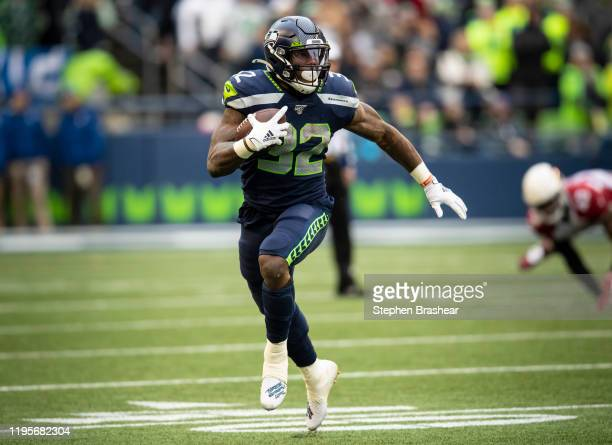 Running back Chris Carson of the Seattle Seahawks rushes the ball during a game against the Arizona Cardinals at CenturyLink Field on December 22,...