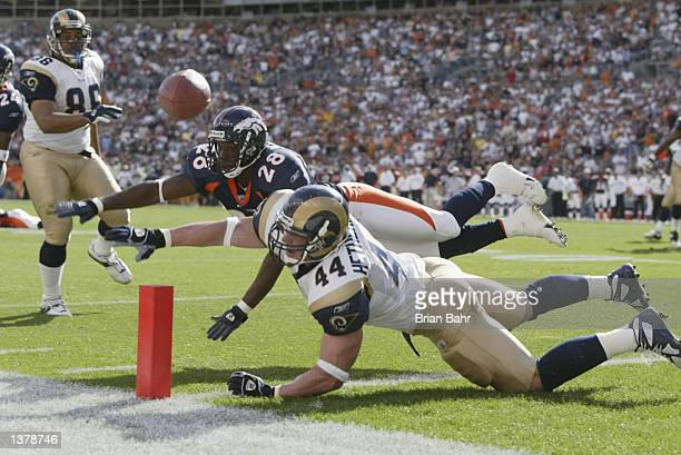 Running back Chris Hetherington of the St Louis Rams can't catch a pass on fourth down and one from the nine yard line under coverage from safety...