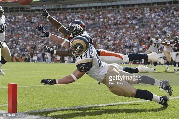 Running back Chris Hetherington of the St Louis Rams dives too early on fourth down and one from the nine yard line under coverage from safety Kenoy...
