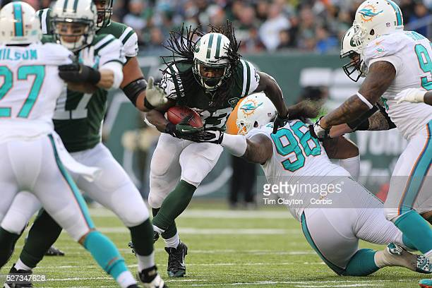 Running back Chris Ivory, New York Jets, is tackled by Paul Soliai, Miami Dolphins, during the New York Jets Vs Miami Dolphins NFL American Football...