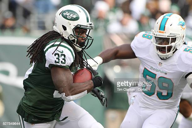 Running back Chris Ivory, New York Jets, shakes off the challenge of Dannell Ellerbe, Miami Dolphins, in action during the New York Jets Vs Miami...