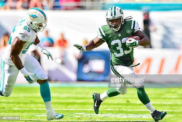 Running back Chris Ivory of the New York Jets carries the ball during a game against the Miami Dolphins at Sun Life Stadium on December 28, 2014 in...