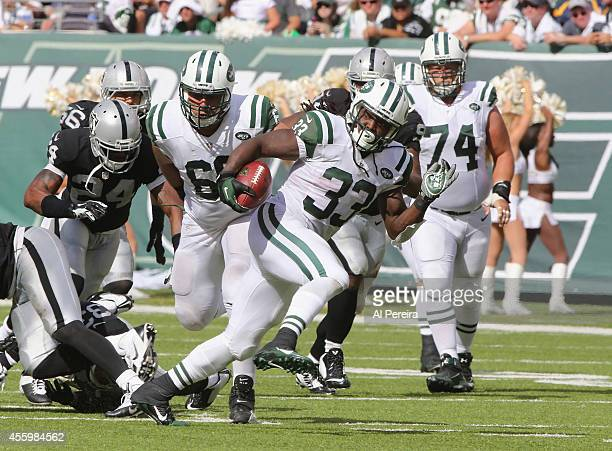 Running Back Chris Ivory of the New York Jets has a 71-yard Touchdown run against the Oakland Raiders at MetLife Stadium on September 7, 2014 in East...