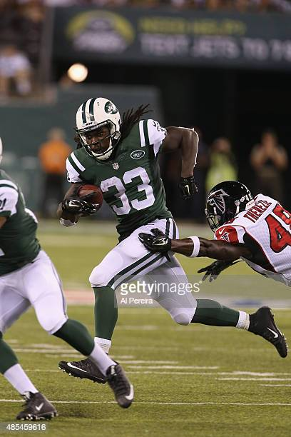 Running Back Chris Ivory of the New York Jets has a long gain against the Atlanta Falcons at MetLife Stadium on August 21, 2015 in East Rutherford,...